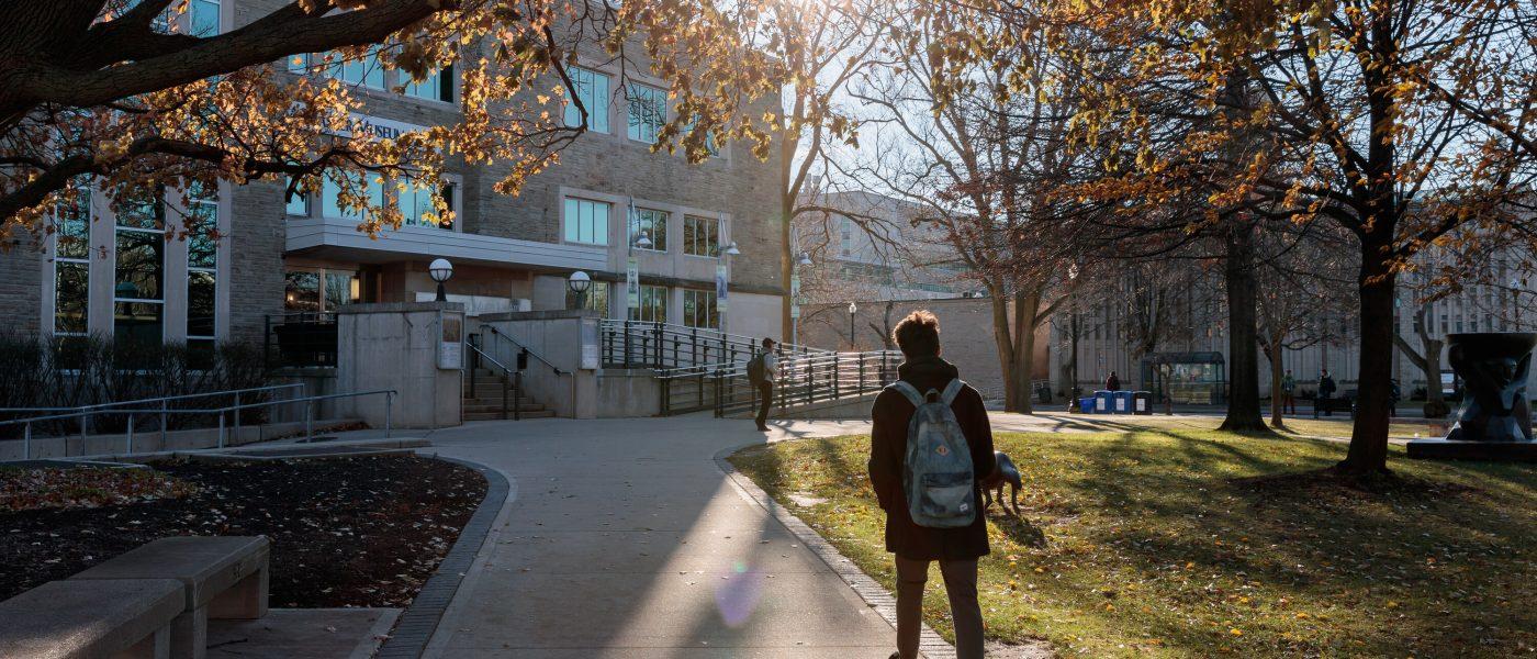 Student Walking Towards McMaster Museum of Art