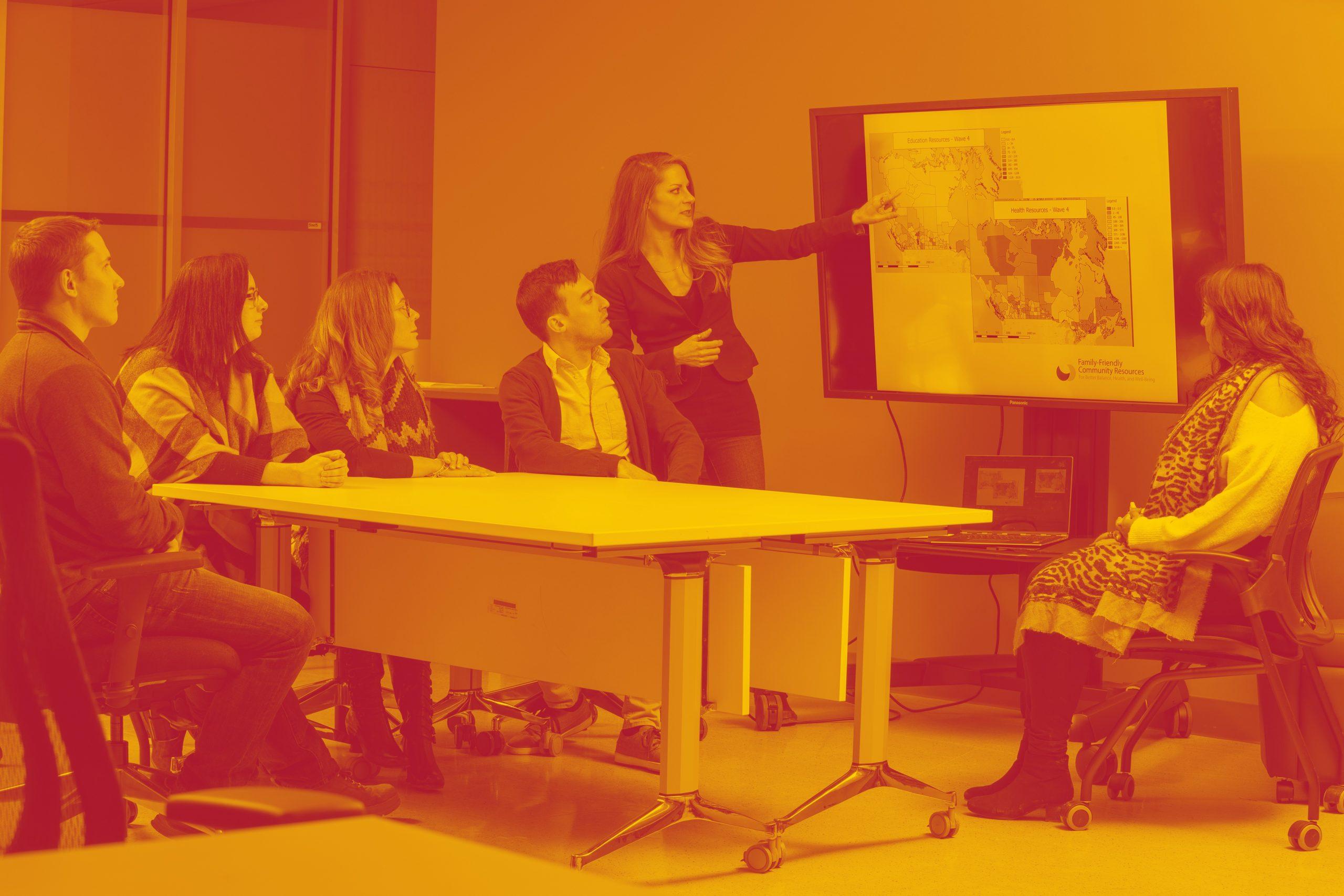 Marisa Young Teaching on Large Screen